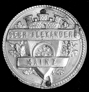 Maker's medallion in original case.