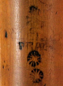 Maker's stamp on top joint of basset horn.