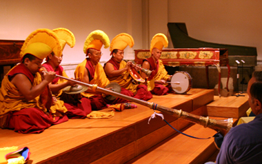 Tibetan Monks demonstrate ceremonial instruments