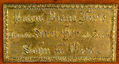 Embossed brass plate bearing maker's name.
