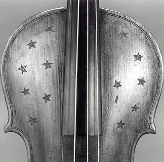 Stars incised on violin belly