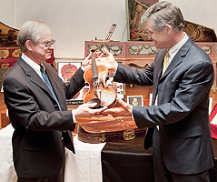 Kevin Schieffer presents The King Henry IV violin to Andre P. Larson