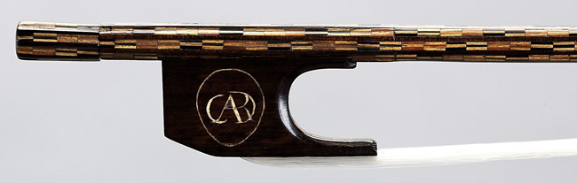 Monogram of King Charles IV on frog of NMM 4882.  Violin bow attributed to the workshop of Antonio Stradivari, Cremona, ca. 1700.  Arne B. and Jeanne F. Larson Fund, 1989.