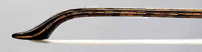 Tip of NMM 4882.  Violin bow attributed to the workshop of Antonio Stradivari, Cremona, ca. 1700.  Arne B. and Jeanne F. Larson Fund, 1989.